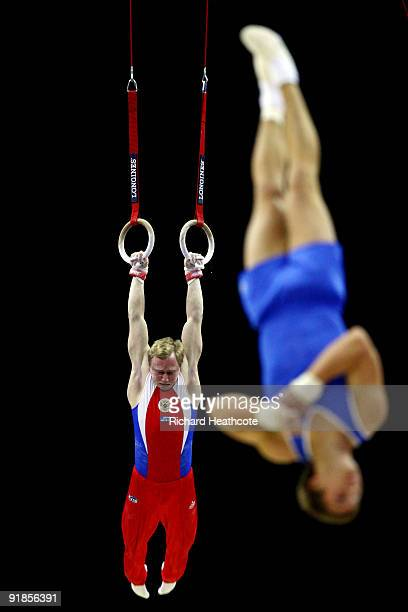 Aleksandr Balandin of Russia and Viktor Kristmannsson of Iceland compete during the Artistic Gymnastics World Championships 2009 at O2 Arena on...