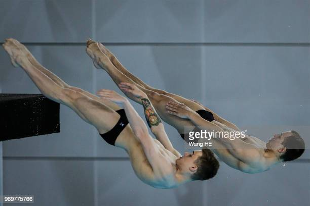 Aleksandr Belevtsev and Nikita Shleikher of Russia compete in the men's 10m Synchro Springboard final on FINA Diving World Cup 2018 at the Wuhan...