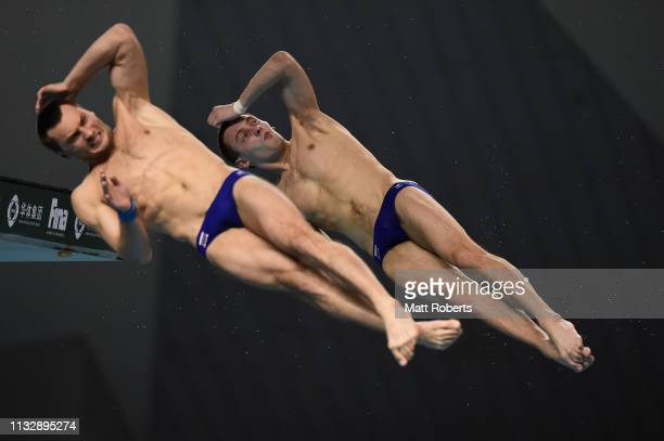 Aleksandr Bondar and Viktor Minibaev of Russia compete during the Men's 10m Platform Synchro Final on day one of the FINA Diving World Cup Sagamihara...