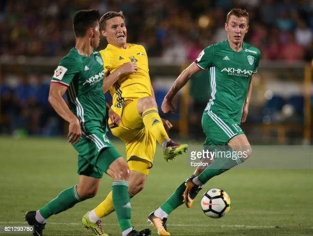 Aleksandr Bukharov of FC Rostov RostovonDon is challenged by Wilker Angel and Andrei Semyonov of FC Akhmat Grozny during the Russian Premier League...