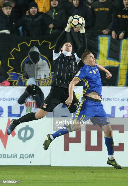 Aleksandr Bukharov of FC Rostov RostovonDon vies for the ball with Aleksandr Belenov of FC Ufa during the Russian Premier League match between FC...