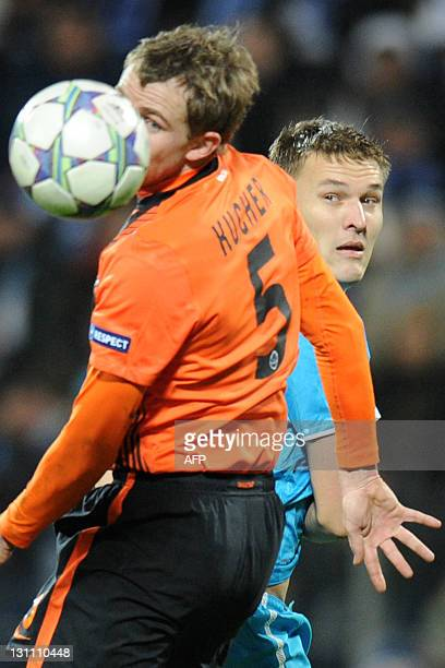 Aleksandr Bukharov of FC Zenit St Petersburg fights for the ball against Olexandr Kucher of FC Shakhtar during UEFA Champions League Group G football...
