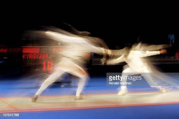 Aleksandr Chernykh of Kyrgyzstan competes in the Men's Team Epee Round of 16 Match 2 against Abdullah Ebrahimi of Qatar at Guangda Gymnasium during...