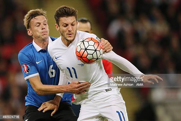 Aleksandr Dmitrijev of Estonia and Adam Lallana of England in action during the UEFA Euro 2016 Qualifier match between England and Estonia at Wembley...