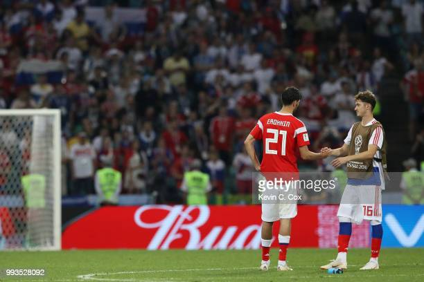Aleksandr Erokhin and Anton Miranchuk of Russia look dejected following their team's defeat in the 2018 FIFA World Cup Russia Quarter Final match...