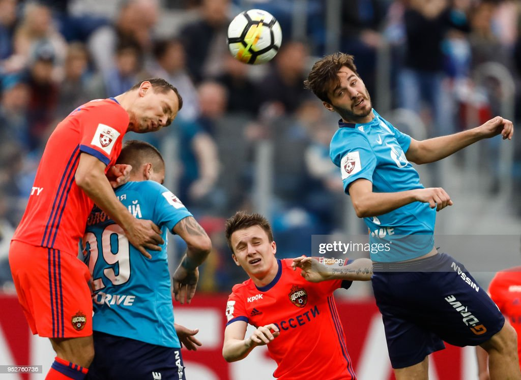 Aleksandr Erokhin (R) and Anton Zabolotny (2nd L) of FC Zenit Saint Petersburg vie for the ball with Sergei Ignashevich (L) and Aleksandr Golovin of PFC CSKA Moscow during the Russian Football League match between FC Zenit Saint Petersburg and PFC CSKA Moscow on April 29, 2018 at Saint Petersburg Stadium in Saint Petersburg, Russia.