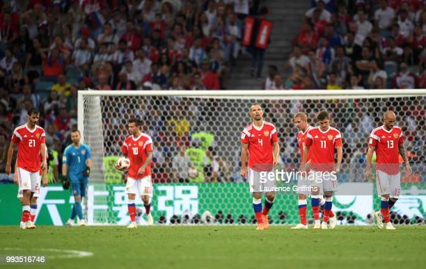 Aleksandr Erokhin Igor Akinfeev Fedor Smolov Sergey Ignashevich Roman Zobnin and Fedor Kudriashov of Russia walk away dejected after the second...