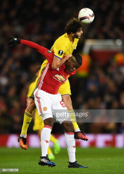Aleksandr Erokhin of FC Rostov rises above Paul Pogba of Manchester United to win a header during the UEFA Europa League Round of 16 second leg match...