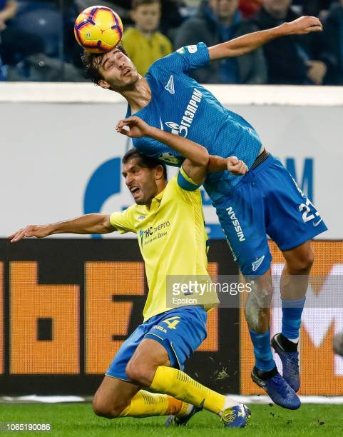Aleksandr Erokhin of FC Zenit Saint Petersburg and Alexandru Gatcan of FC Rostov vie for the ball during the Russian Premier League match between FC...