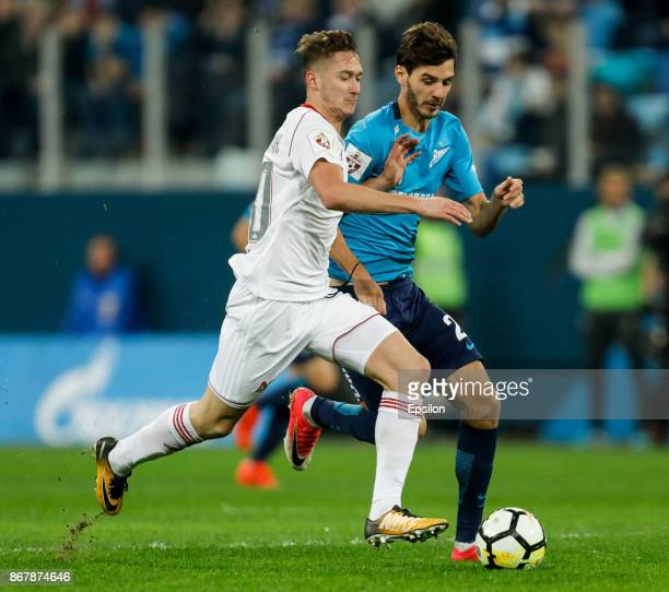 Aleksandr Erokhin of FC Zenit Saint Petersburg and Anton Miranchuk of FC Lokomotiv Moscow vie for the ball during the Russian Football League match...