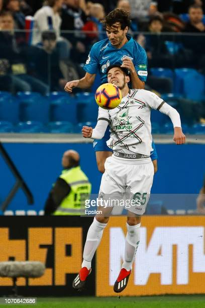 Aleksandr Erokhin of FC Zenit Saint Petersburg and Artur Sagitov of FC Rubin Kazan vie for the ball during the Russian Premier League match between...