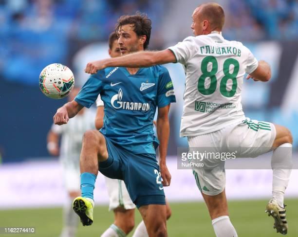 Aleksandr Erokhin of FC Zenit Saint Petersburg and Denis Glushakov of FC Akhmat Grozny vie for the ball during the Russian Premier League match...