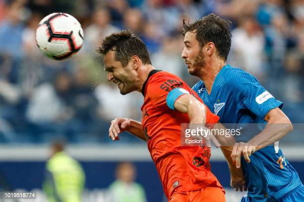 Aleksandr Erokhin of FC Zenit Saint Petersburg and Denys Kulakov of FC Ural Ekaterinburg vie for the ball during the Russian Premier League match...