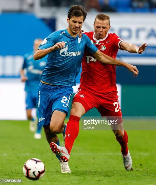 Aleksandr Erokhin of FC Zenit Saint Petersburg and Dmitri Tarasov of FC Lokomotiv Moscow vie for the ball during the Russian Premier League match...