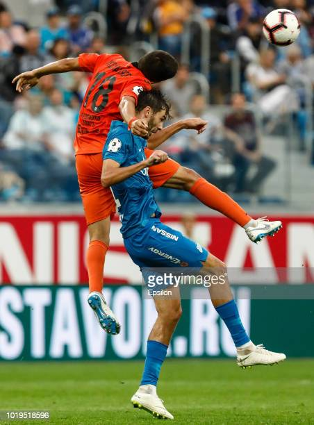 Aleksandr Erokhin of FC Zenit Saint Petersburg and Dzhamaldin Khodzhaniyazov of FC Ural Ekaterinburg vie for the ball during the Russian Premier...