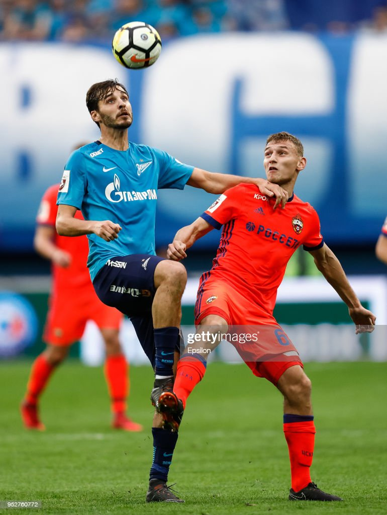Aleksandr Erokhin (L) of FC Zenit Saint Petersburg and Fyodor Chalov of PFC CSKA Moscow vie for the ball during the Russian Football League match between FC Zenit Saint Petersburg and PFC CSKA Moscow on April 29, 2018 at Saint Petersburg Stadium in Saint Petersburg, Russia.