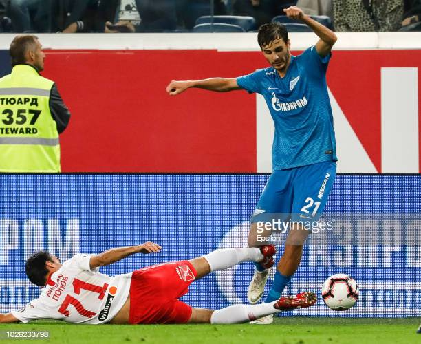 Aleksandr Erokhin of FC Zenit Saint Petersburg and Ivelin Popov of FC Spartak Moscow vie for the ball during the Russian Premier League match between...