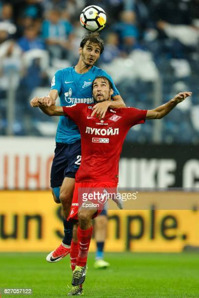 Aleksandr Erokhin of FC Zenit Saint Petersburg and Ivelin Popov of FC Spartak Moscow vie for the ball during the Russian Football League match...