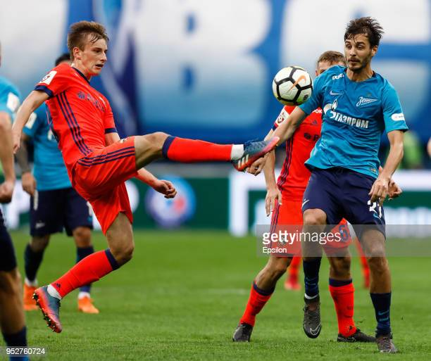 Aleksandr Erokhin of FC Zenit Saint Petersburg and Konstantin Kuchayev of PFC CSKA Moscow vie for the ball during the Russian Football League match...