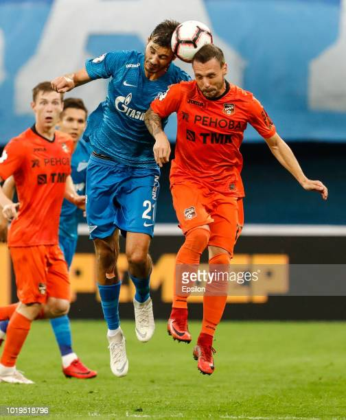 Aleksandr Erokhin of FC Zenit Saint Petersburg and Nikolay Dimitrov of FC Ural Ekaterinburg vie for the ball during the Russian Premier League match...