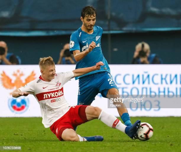 Aleksandr Erokhin of FC Zenit Saint Petersburg and Nikolay Rasskazov of FC Spartak Moscow vie for the ball during the Russian Premier League match...
