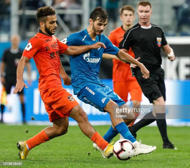 Aleksandr Erokhin of FC Zenit Saint Petersburg and Othman El Kabir of FC Ural Ekaterinburg vie for the ball during the Russian Premier League match...