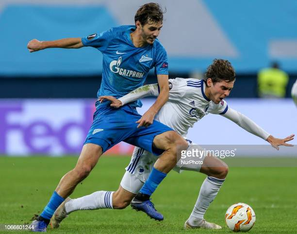 Aleksandr Erokhin of FC Zenit Saint Petersburg and Robert Skov of FC Copenhagen vie for the ball during the Group C match of the UEFA Europa League...