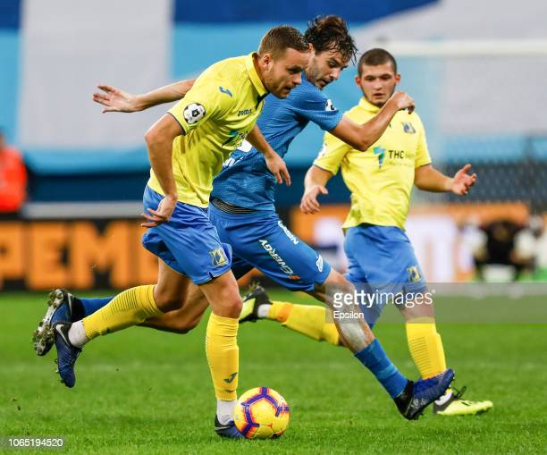Aleksandr Erokhin of FC Zenit Saint Petersburg and Sverrir Ingi Ingason of FC Rostov vie for the ball during the Russian Premier League match between...