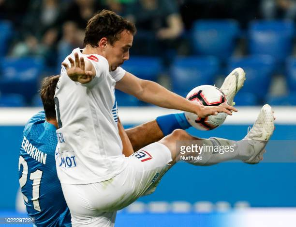 Aleksandr Erokhin of FC Zenit Saint Petersburg and Vegard Forren of Molde FK vie for the ball during the UEFA Europa League playoffs first leg match...