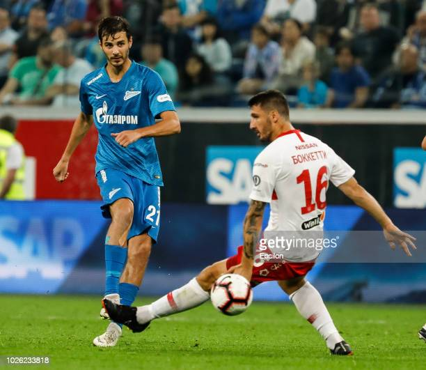 Aleksandr Erokhin of FC Zenit Saint Petersburg passes the ball as Salvatore Bocchetti of FC Spartak Moscow defends during the Russian Premier League...
