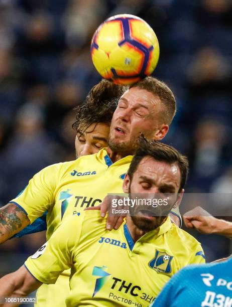 Aleksandr Erokhin of FC Zenit Saint Petersburg Ragnar Sigurdsson and Maciej Wilusz of FC Rostov vie for a header during the Russian Premier League...