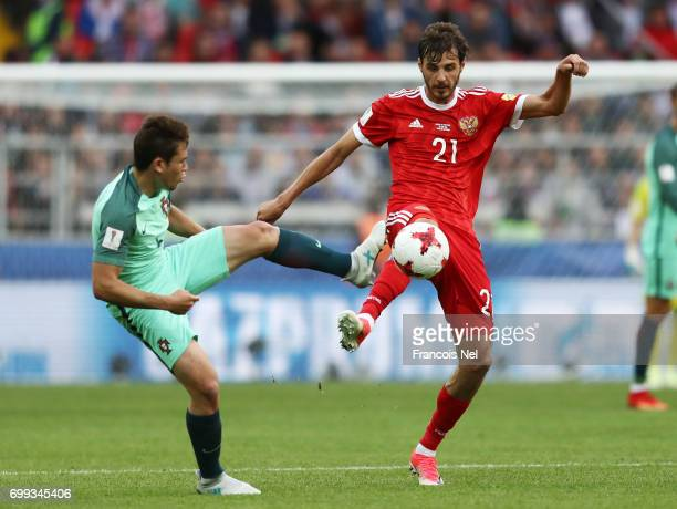 Aleksandr Erokhin of Russia and Raphael Guerreiro of Portugal during the FIFA Confederations Cup Russia 2017 Group A match between Russia and...