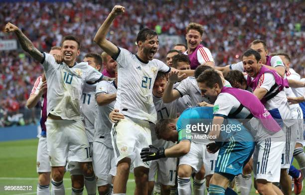 Aleksandr Erokhin of Russia celebrates after his team win a penalty shoot out during the 2018 FIFA World Cup Russia Round of 16 match between Spain...
