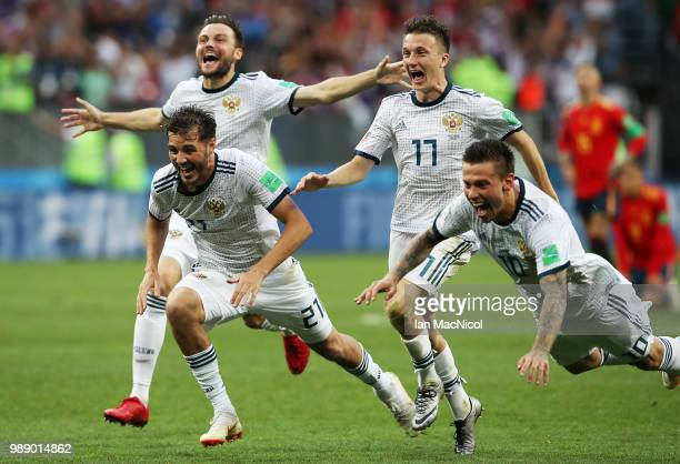 Aleksandr Erokhin of Russia celebrates when they win the penalty shoot out during the 2018 FIFA World Cup Russia Round of 16 match between Spain and...
