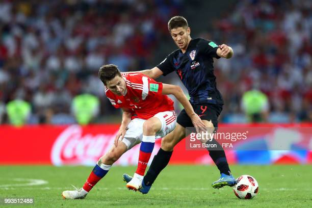 Aleksandr Erokhin of Russia challenge for the ball with Andrej Kramaric of Croatia during the 2018 FIFA World Cup Russia Quarter Final match between...