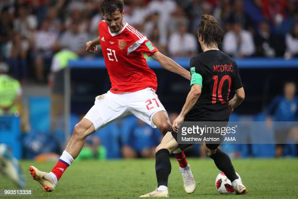 Aleksandr Erokhin of Russia competes with Luka Modric of Croatia during the 2018 FIFA World Cup Russia Quarter Final match between Russia and Croatia...