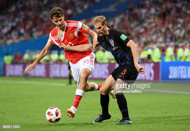 Aleksandr Erokhin of Russia is challenged by Ivan Strinic of Croatia during the 2018 FIFA World Cup Russia Quarter Final match between Russia and...