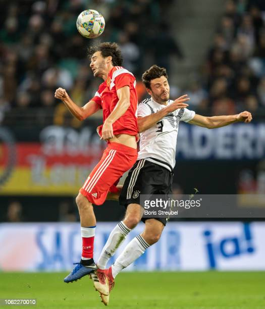 Aleksandr Erokhin of Russia jumps for a header with Jonas Hector of Germany during the International Friendly match between Germany and Russia at Red...
