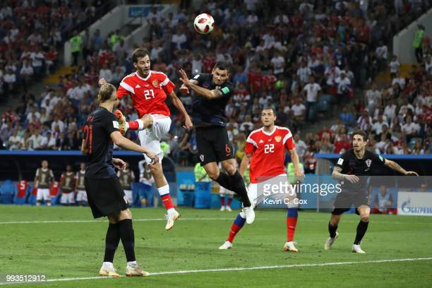 Aleksandr Erokhin of Russia wins a header over Dejan Lovren of Croatia during the 2018 FIFA World Cup Russia Quarter Final match between Russia and...