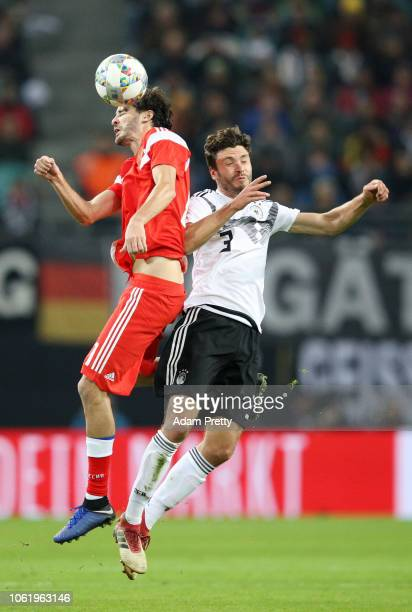 Aleksandr Erokhin of Russia wins a header over Jonas Hector of Germany during the International Friendly match between Germany and Russia at Red Bull...