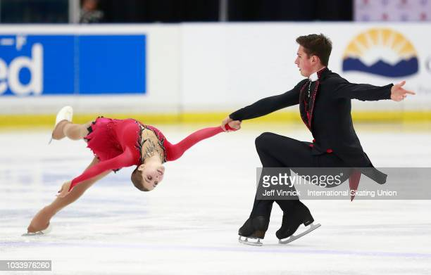 Aleksandr Galliamov and Anastasia Mishina of Russia perform during their gold medal junior pairs final skate during the 2018 Junior Grand Prix of...
