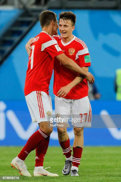 Aleksandr Golovin and Roman Zobnin of Russia national team celebrate victory during the 2018 FIFA World Cup Russia group A match between Russia and...