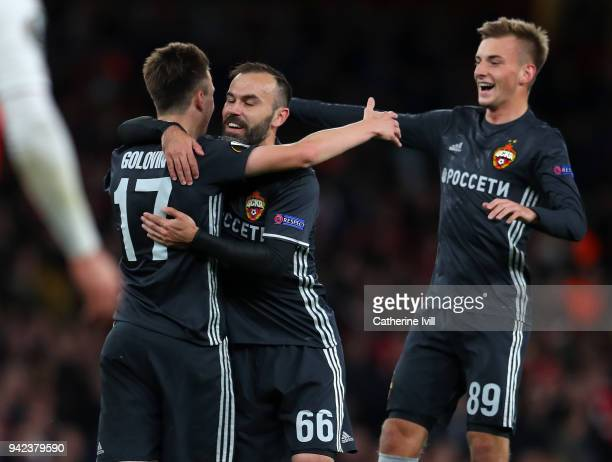 Aleksandr Golovin of CSKA Moskva is congratulated on scoring the equalising goal by Bibras Natcho and Konstantin Kuchaev during the UEFA Europa...