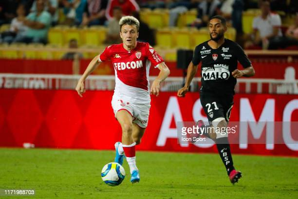 Aleksandr GOLOVIN OF MONACO and Jean-Charles CASTELETTO OF BREST during the Ligue 1 match between AS Monaco and Stade Brest at Stade Louis II on...
