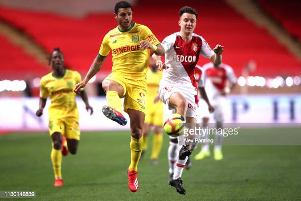 Aleksandr Golovin of Monaco and Joris Kayembe of Nantes compete for the ball during the Ligue 1 match between AS Monaco and FC Nantes at Stade Louis...