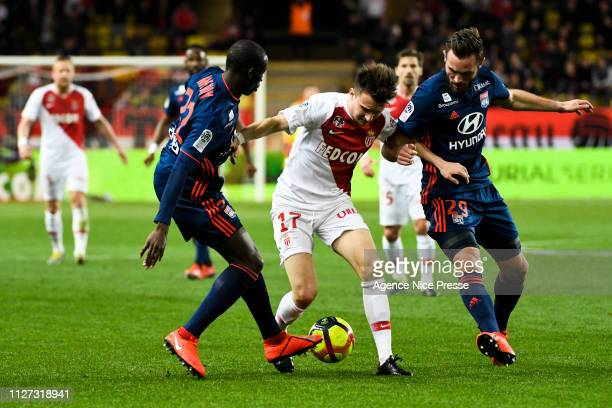 Aleksandr Golovin of Monaco and Lucas Tousart and Ferland Mendy of Lyon during the Ligue 1 match between Monaco and Lyon at Stade Louis II on...