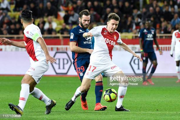 Aleksandr Golovin of Monaco and Lucas Tousart of Lyon during the Ligue 1 match between Monaco and Lyon at Stade Louis II on February 24 2019 in...