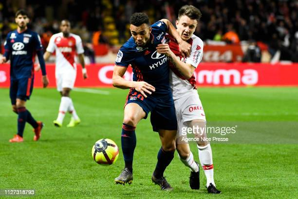 Aleksandr Golovin of Monaco and Marcal of Lyon during the Ligue 1 match between Monaco and Lyon at Stade Louis II on February 24 2019 in Monaco Monaco