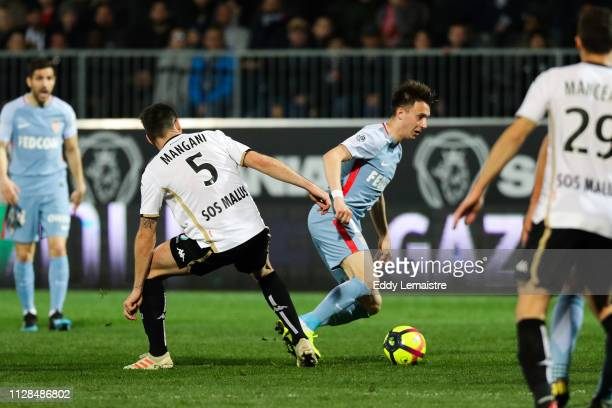 Aleksandr Golovin of Monaco and Thomas Mangani of Angers during the Ligue 1 match between SCO Angers and AS Monaco on March 2 2019 in Angers France
