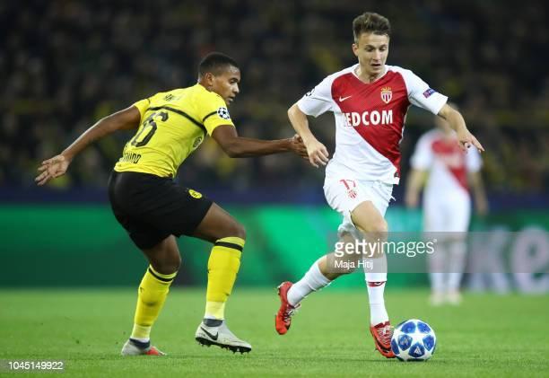 Aleksandr Golovin of Monaco evades Manuel Akanji of Borussia Dortmund during the Group A match of the UEFA Champions League between Borussia Dortmund...